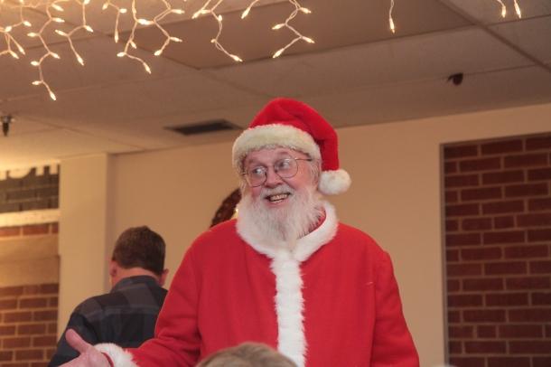 Santa greets the guests.